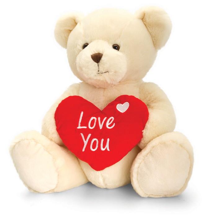 """Nalle som håller i ett hjärta med texten """"Love you"""""""